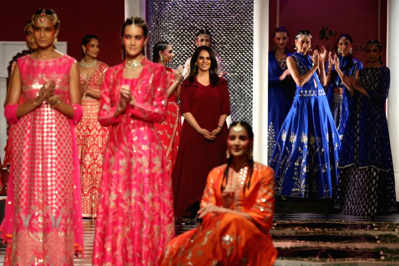 Models walk the ramp for designer Anita Dongre?s fashion show at Day 2 of FDCI India Couture Week.