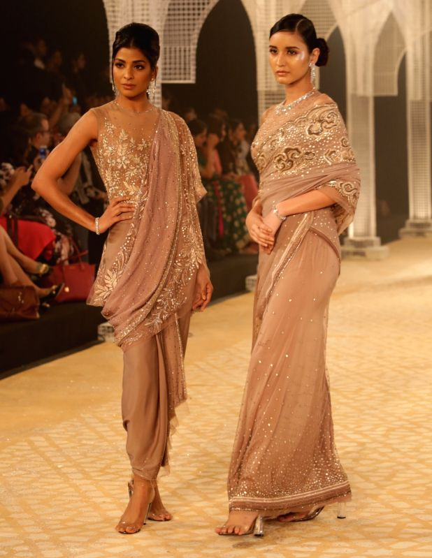 Models walk the ramp for designer Tarun Tahiliani at India Couture Week 2018 in New Delhi on July 25, 2018.