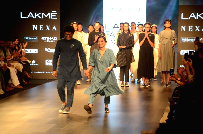 Models walk the ramp for fashion designer Malu during the Lakme Fashion Week Summer/Resort 2018 in Mumbai on Feb 1, 2018.