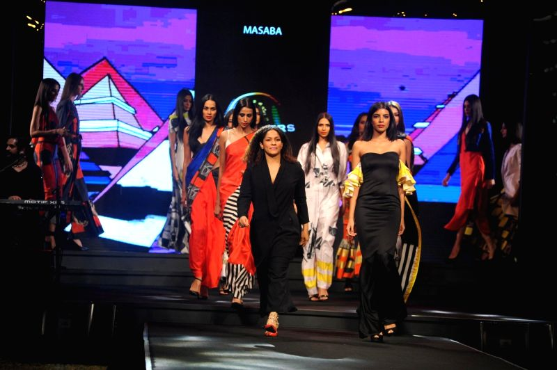 Models walk the ramp showcasing designer Masaba's collection at the Blenders Pride Fashion Tour 2015 in Mumbai  Dec 5, 2015.