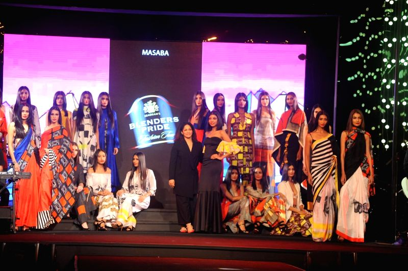 Models walk the ramp showcasing designer Masaba's collection at the Blenders Pride Fashion Tour 2015 in Mumbai  Dec 5, 2015.