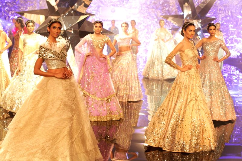 Models walk the ramp showcasing fashion designer Suneet Verma's creation at India Couture Week 2018, in New Delhi on July 27, 2018. - Suneet Verma