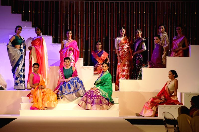 "Models walk the ramp showcasing ""Threads of Banaras"" - during India-Africa Forum Summit 2015 in New Delhi on Oct 29, 2015."