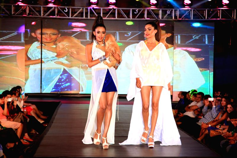 Models walk the ramp with dogs during the promotion of film Entertainment in Bengaluru on August 5, 2014.