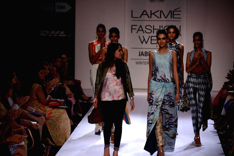 Models walks on the ramp for designer Sania Maskatiya during the Lakme Fashion Week (LFW) Winter/ Festive 2014 in Mumbai, on Aug. 20, 2014.
