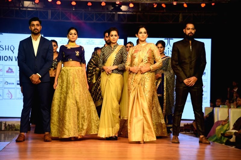 Models walks the ramp during a fashion show organised in Patna on Aug 11, 2018.