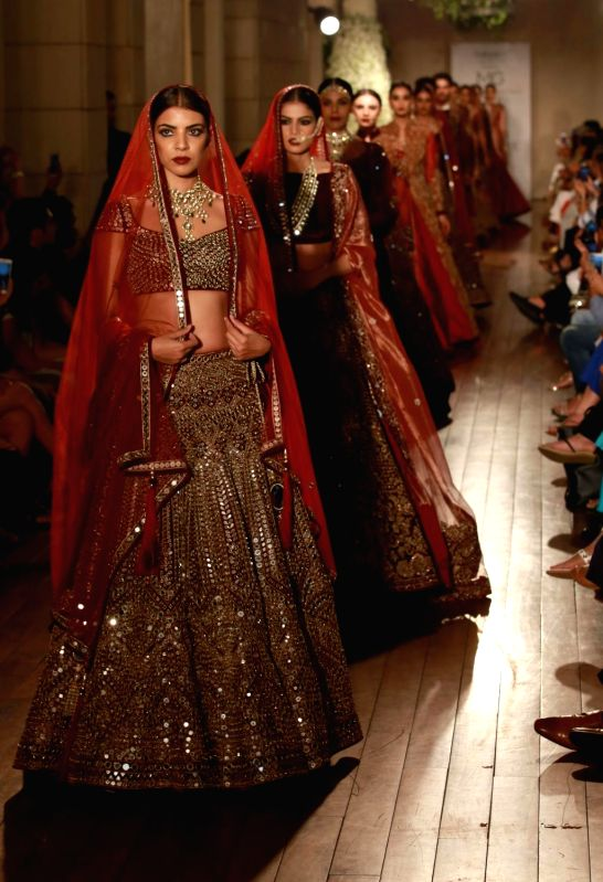Models walks the ramp during designer Manav Gangwani's show at the India Couture Week 2016, in New Delhi on July 24, 2016.