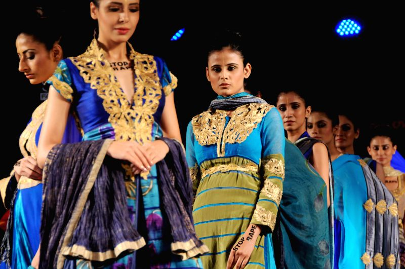 Models walks the ramp during the Kingfisher Ultra Style Week in Bangalore on July 25, 2014.