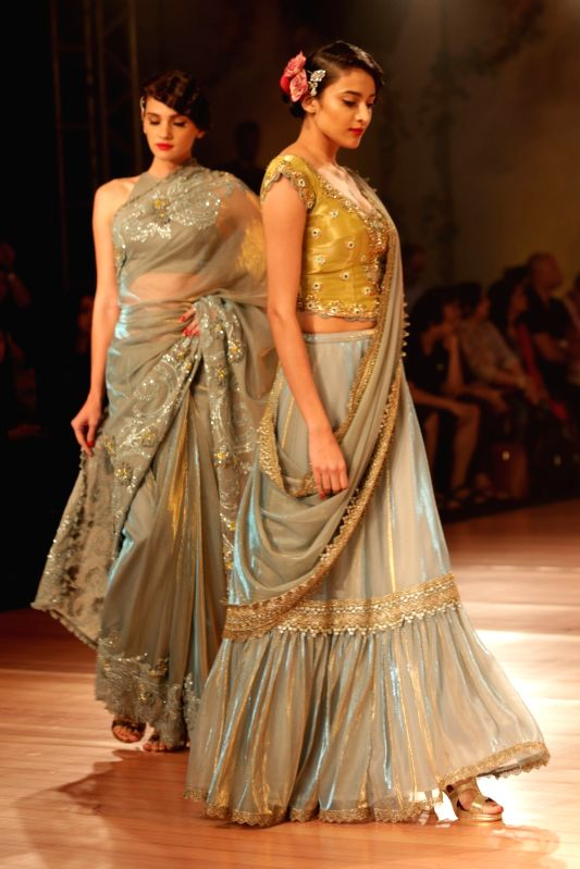 Models walks the ramp for designer Pallavi Jaikishan at India Couture Week 2018 in New Delhi on July 26, 2018.