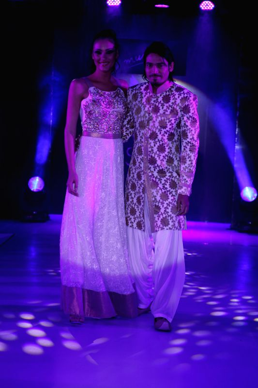Models walks the ramp showcasing creations of fashion designer Mumtaz Khan during Kingfisher Ultra Style Week Bangalore 2014 on July 27, 2014. - Mumtaz Khan