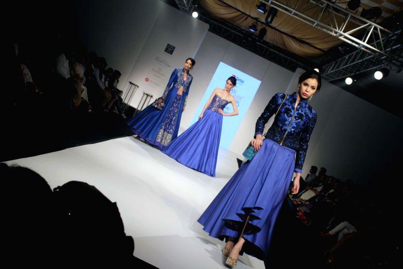 Models walks the ramp to showcase designer Charu Parashar`s collection at Asian Designer Week 2015 in New Delhi, on Oct 31, 2015.