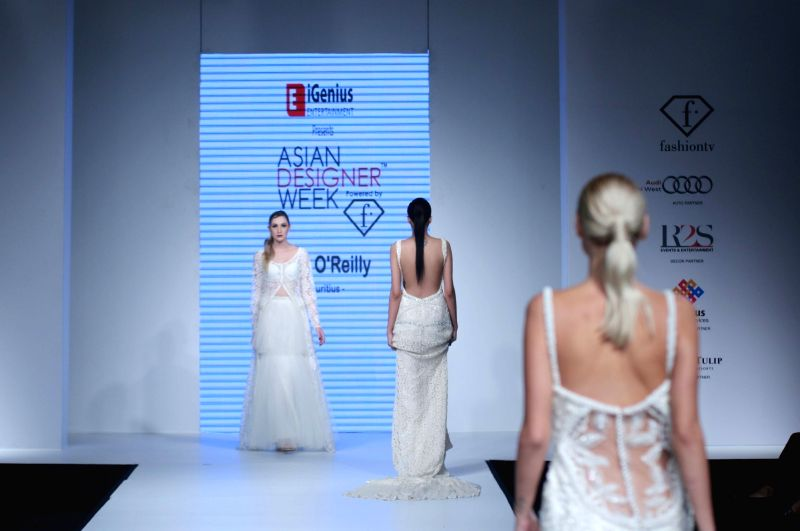 Models walks the ramp to showcase designer Lida O`Reilly`s collection at Asian Designer Week 2015 in New Delhi, on Oct 31, 2015.
