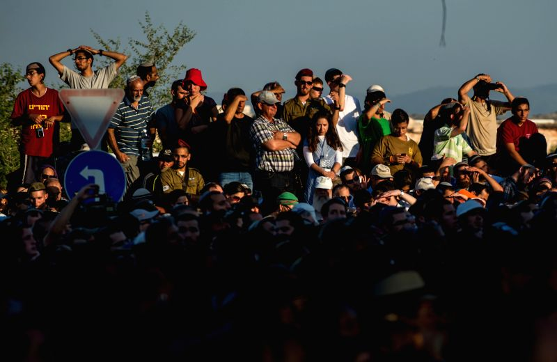 MODI'People participate in a joint funeral for the three Israeli teens at a cemetery in Modi'in near Jerusalem, on July 1, 2014. The three Israeli teens whose bodies were - Benjamin Netanyahu