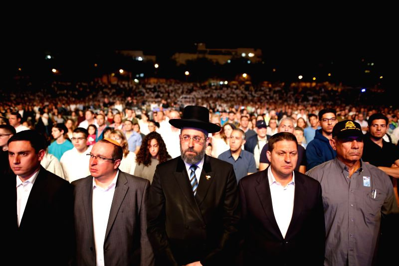 MODI'Israeli citizens and soldiers stand in silence during a ceremony marking Remembrance Day in Modi'in, on April 30, 2017.