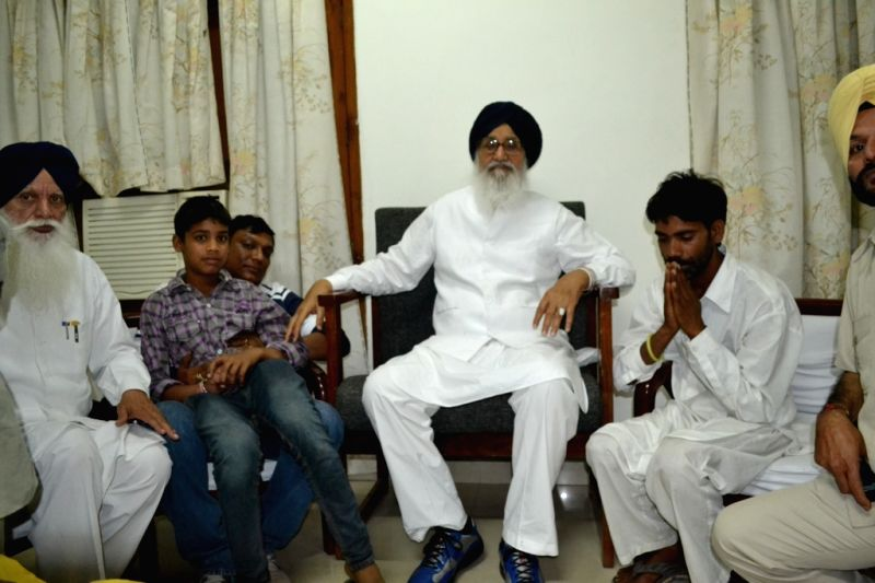Punjab Chief Minister Parkash Singh Badal meets the family of the 13-year old Moga bus tragedy victim, in Moga, Punjab on May 3, 2015. - Parkash Singh Badal