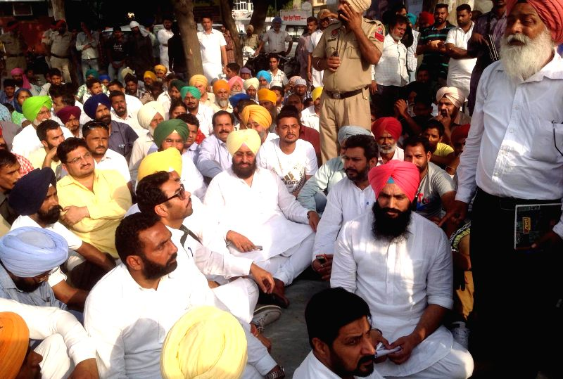 Punjab Congress president Partap Singh Bajwa stages a demonstration against the death of a 13-year-old girl who jumped out of a moving bus to escape molestation nea Moga on April 30, 2015. - Partap Singh Bajwa