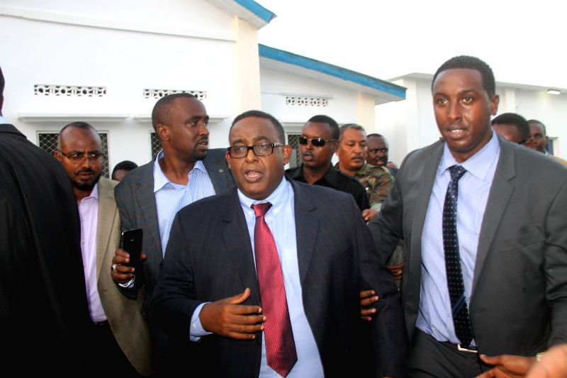 Omar Abdirashid Ali Sharmarke (C) arrives to attend a press conference at the presidential palace in Mogadishu, capital of Somalia, Dec. 17, 2014. Somalia's ...