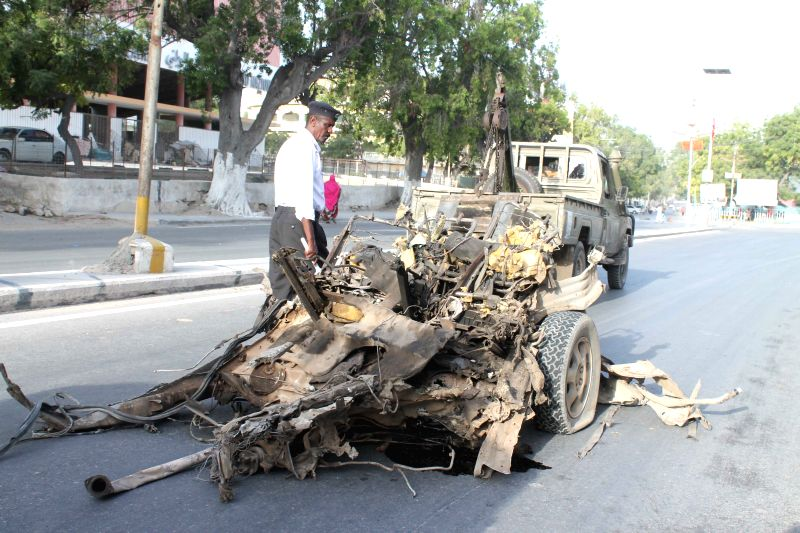 Photo taken on Jan. 22, 2015 shows the scene of suicide car bomb attack at SYL hotel in Mogadishu, Somalia.?At least five people were killed and several others ...