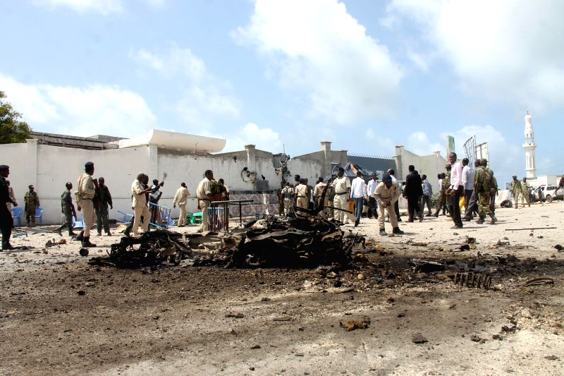 Security forces keep guard at an explosion site outside the Somali parliament building in Mogadishu, capital of Somalia, July 5, 2014. At least two guards were ...