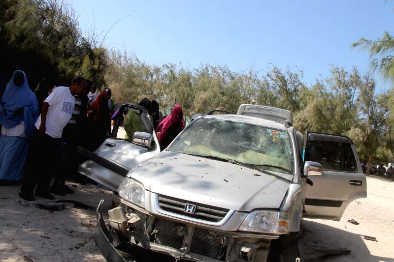 Photo taken on June 18, 2014 shows a damaged car at the blast site at Keysaney Hospital in Mogadishu, Somalia. A car bomb explosion killed one person and wounded .