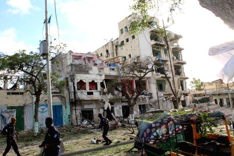 MOGADISHU, June 2, 2016 - Somali security forces guard the suicide car bomb site at Ambassador Hotel in Mogadishu, capital of Somalia, June 2, 2016. Africa Union (AU)'s top envoy for Somalia on ...