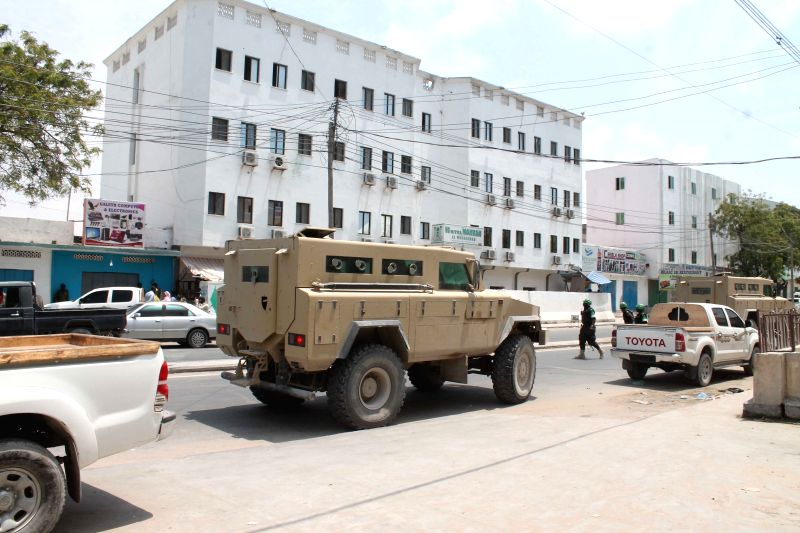Military vehicles are seen outside Maka Al-mukarama hotel in Mogadishu, capital of Somalia, March 28, 2015. More than 14 people were killed during an Al-Shabaab ...
