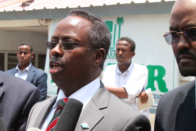 Somali Information Minister Mohamed Abdi Hayir (C) speaks during a press conference in Mogadishu, capital of Somalia, March 28, 2015. More than 14 people were ... - Mohamed Abdi Hayir