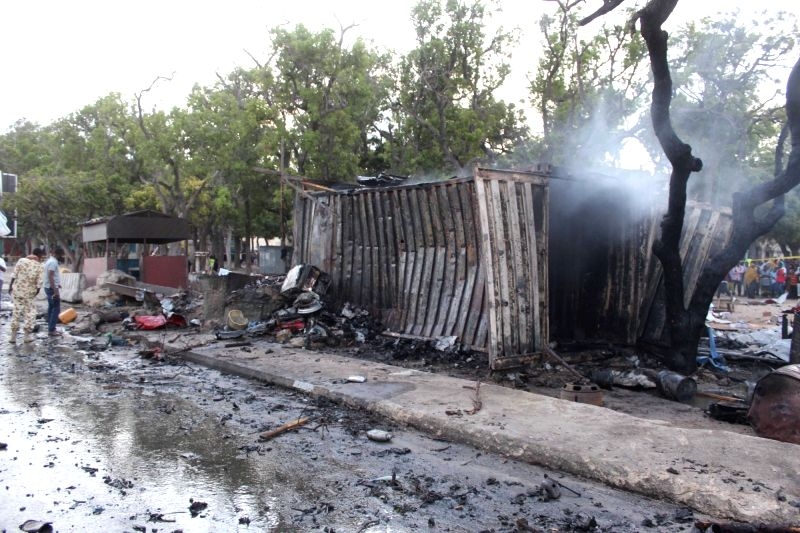 MOGADISHU, May 25, 2017 - Photo taken on May 24, 2017 shows the site of a car bomb explosion in Mogadishu, Somalia. At least five people were killed and an unknown number injured in a massive car ...