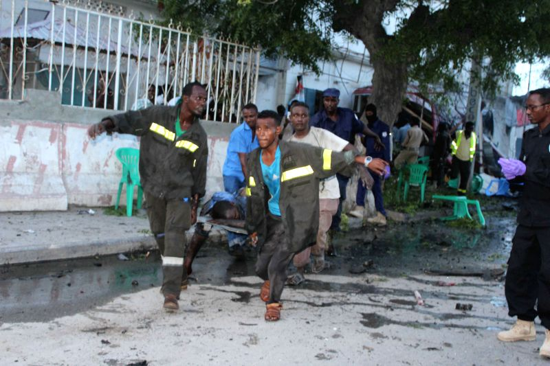 MOGADISHU, May 8, 2017 - Medical personnel carry the injured out of the site of a blast in Mogadishu, Somalia, May 8, 2017. A huge blast occurred near Sunrise Hotel in Maka Almukarama in the ...
