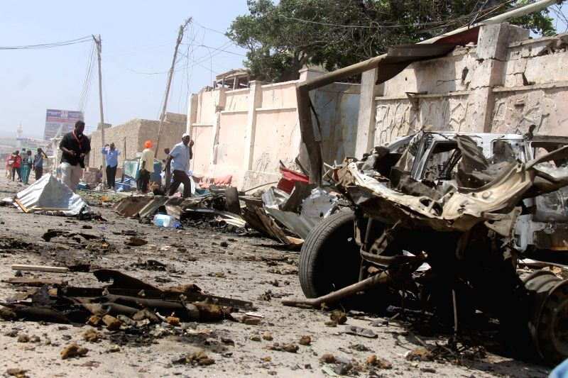Photo taken on Dec. 3, 2014 shows the debris of a car explosion outside the airport in Mogadishu, capital of Somalia. At least four people were killed in a suicide car bomb attack against .