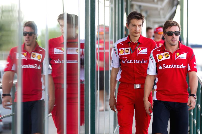Ferrari driver Fernando Alonso (R) of Spain walks to a drivers' briefing during the F1 Hungarian Grand Prix at Hungaroring in Mogyorod, Hungary on July 25, 2014. ..