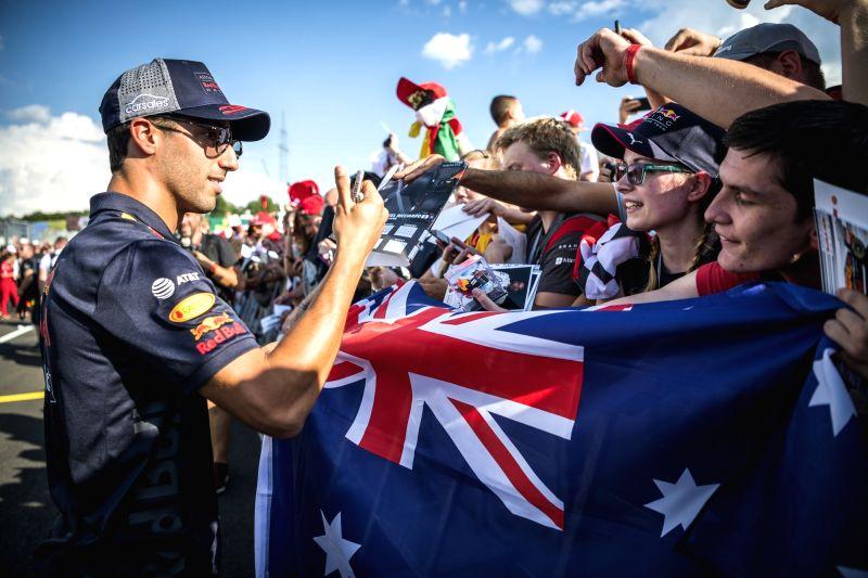 MOGYOROD, July 27, 2018 - Red Bull driver Daniel Ricciardo (L) of Australia signs autographs ahead of the Hungarian F1 Grand Prix on the Hungaroring circuit in Mogyorod, Hungary on July 26, 2018.