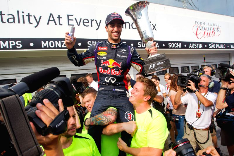 Red Bull Formula One driver Daniel Ricciardo (above) of Australia celebrates victory with teammates at the F1 Hungarian Grand Prix in Mogyorod, Hungary on July 27,
