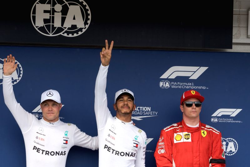 MOGYOROD, July 29, 2018 - Valtteri Bottas (L) of Finland, Lewis Hamilton (C) of Britain and Kimi Raikkonen of Finland pose for photos after the qualifying session of the Hungarian Formula One Grand ...