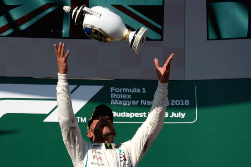 MOGYOROD, July 30, 2018 - Mercedes AMG Petronas F1 Team's Lewis Hamilton throws up his trophy during the awarding ceremony of the Formula One Hungarian Grand Prix in Mogyorod, Hungary on July 29, ...