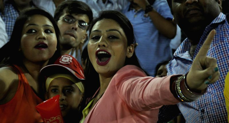 Fans cheer during an IPL-2015 match between Sunrisers Hyderabad  and Kings XI Punjab at  Punjab Cricket Association Stadium in Mohali, Punjab on April 27, 2015.