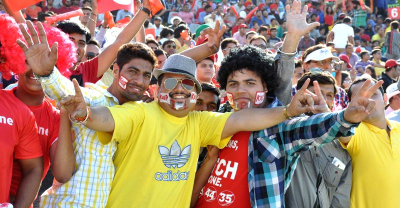 Fans cheer during an IPL-2015 match between Mumbai Indians and Kings XI Punjab at the Punjab Cricket Association Stadium, in Mohali on May 3, 2015.
