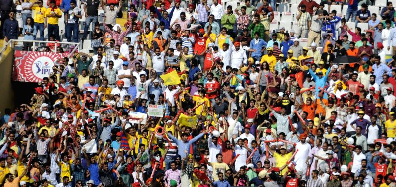 Fans cheer during an IPL-2015 match between Kings XI Punjab and Chennai Super Kings at Punjab Cricket Association Stadium in Mohali on May 16, 2015.