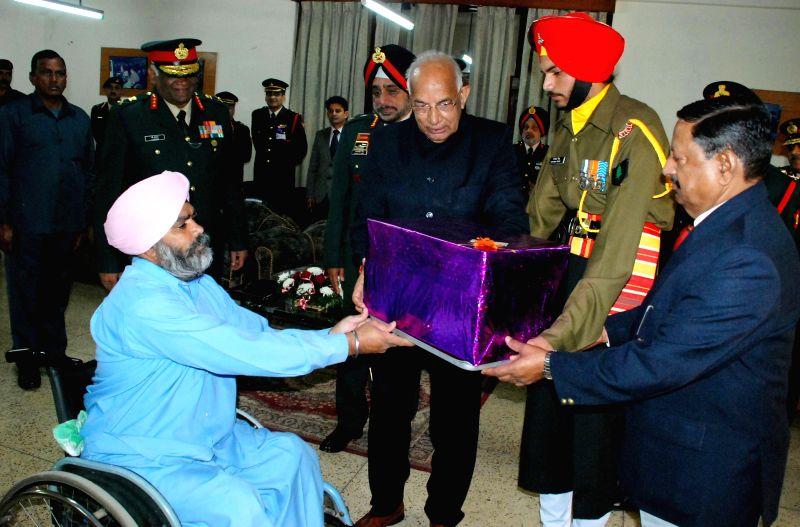 Haryana Governor Kaptan Singh Solanki meet with the inmates of Paraplegic Rehabilitation Centre in Mohali, Punjab on the 37th Raising Day of BSF  on Dec 1, 2014. - Kaptan Singh Solanki