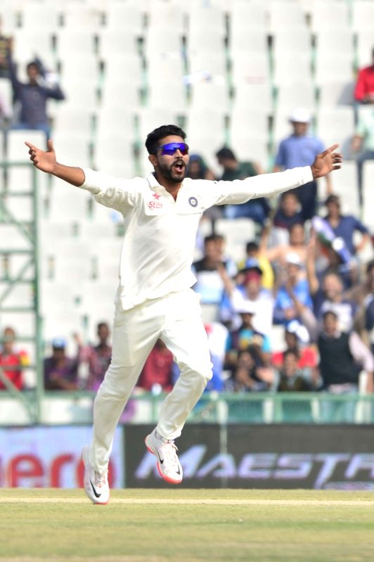 : Mohali: Indian cricketer Ravindra Jadeja celebrates after India`s win against South Africa during the 1st Test match between India and South Africa at Punjab Cricket Association Stadium in Mohali ... - Ravindra Jadeja