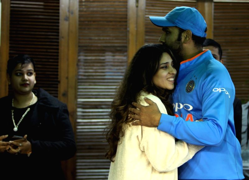 Mohali: Indian cricketer Rohit Sharma with his wife Ritika Sajdeh after he became the first cricketer to score three double hundred in the One-Day International (ODI), at Punjab Cricket Association IS Bindra Stadium in Mohali on Dec 13, 2017. (Photo: