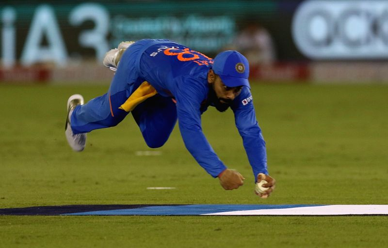 Mohali: Indian skipper Virat Kohli takes the catch of South Africa's Quinton de Kock during the 2nd T20I match between India and South Africa at Punjab Cricket Association IS Bindra Stadium in Mohali on Sep 18, 2019. (Photo: Surjeet Yadav/IANS)