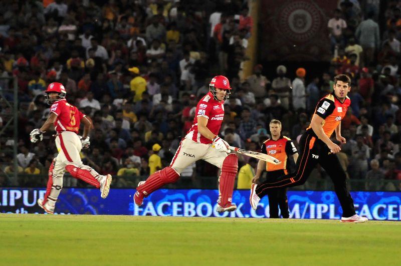 Kings XI Punjab batsmen Wriddhiman Saha and David Miller during an IPL-2015 match between Sunrisers Hyderabad  and Kings XI Punjab at  Punjab Cricket Association Stadium in Mohali, Punjab on ...