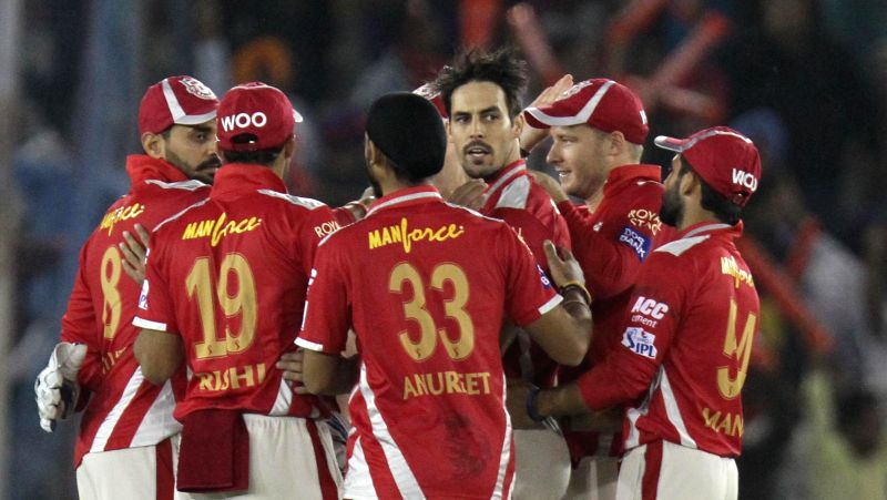 Kings XI Punjab players celebrate fall of a wicket during an IPL-2015 match between Sunrisers Hyderabad  and Kings XI Punjab at  Punjab Cricket Association Stadium in Mohali, Punjab on April ...