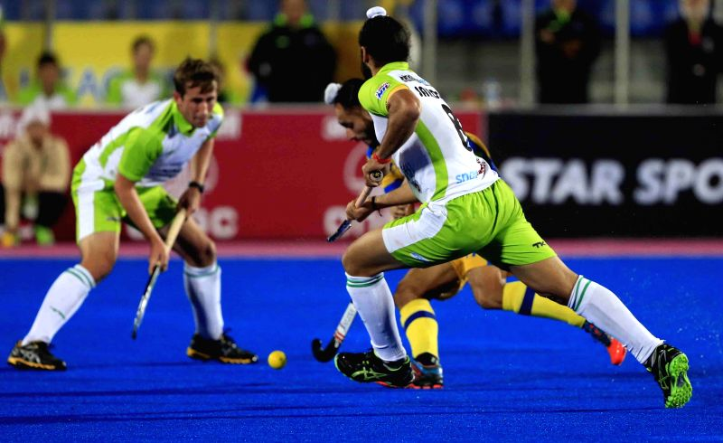 Players in action during a Hockey India League 2015 match between Delhi Waveriders and Jaypee Punjab Warriors at Mohali Hockey Stadium on Feb. 7, 2015.