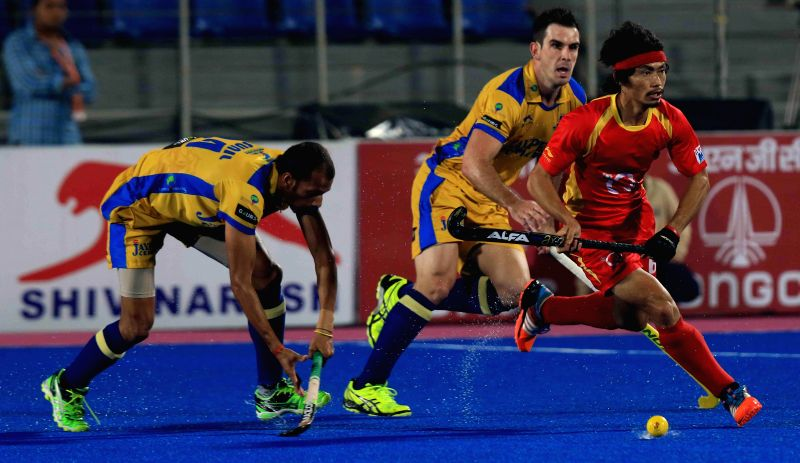 Players in action during a Hockey India League match between Punjab Warriors and Ranchi Rays in Mohali, on Feb 17, 2015. (Photo : IANS)