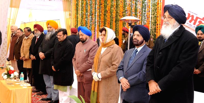 Punjab Chief Minister Parkash Singh Badal and Congress leader and former Punjab chief minister Rajinder Kaur Bhattal during a programme in Mohali, on Dec 26, 2014. - Parkash Singh Badal and Rajinder Kaur Bhattal
