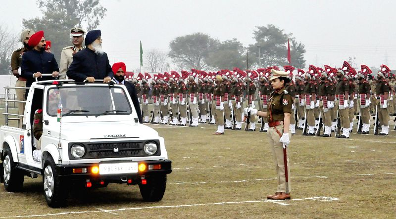 Punjab Chief Minister Parkash Singh Badal inspects guard of honour during a Republic Day programme in Mohali, on Jan 26, 2015. - Parkash Singh Badal