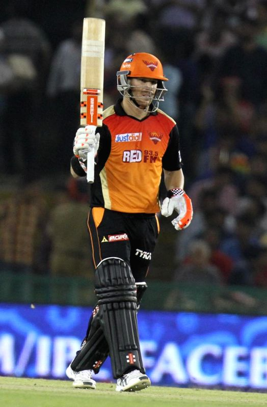 Sunrisers Hyderabad batsman David Warner celebrates his half century during an IPL-2015 match between Sunrisers Hyderabad  and Kings XI Punjab at  Punjab Cricket Association Stadium in ... - David Warner