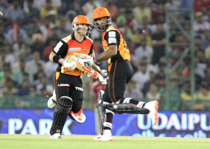 Sunrisers Hyderabad batsmen David Warner and Hanuma Vihari in action during an IPL-2015 match between Sunrisers Hyderabad  and Kings XI Punjab at  Punjab Cricket Association Stadium in ...